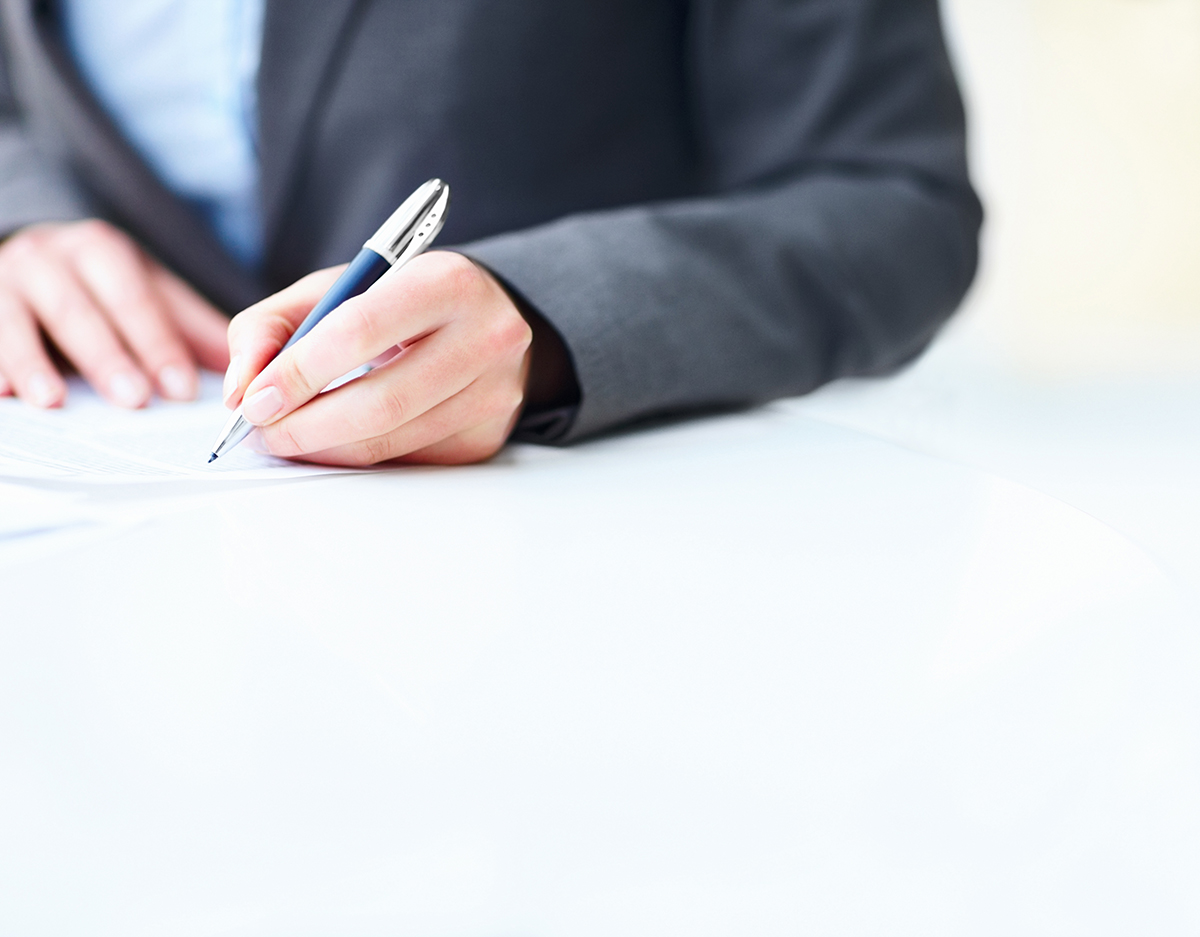 Businesswoman's hands signing a contract